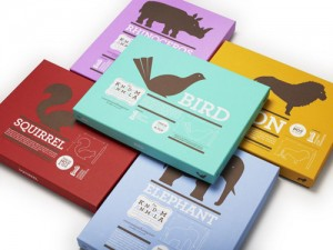 Wooden animal toys packaged in cute eco friendly boxes