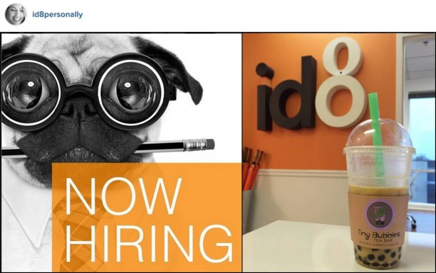 A pug in googly glasses with a pencil in his mouth behind an orange block that says Now Hiring and next to the id8 sign at @id8agency and a Bubble Tea
